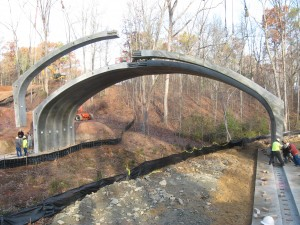 Twin leaf precast concrete arch-box buried bridge